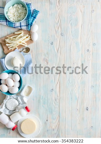 set of dairy products on wooden background with text space top view #354383222