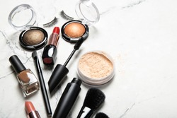 Set of decorative cosmetics on a light background.