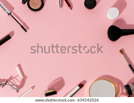 set of decorative cosmetics on color background. space for text