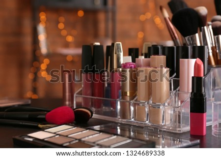 Set of decorative cosmetics on table #1324689338