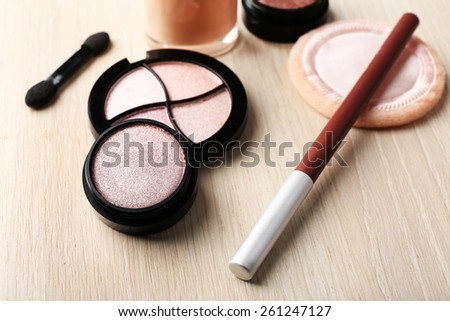 Set of decorative cosmetics on wooden table background