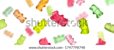 Set of delicious jelly bears falling on white background, banner design