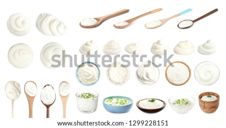 Set of delicious sour cream in dishware on white background