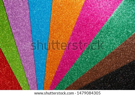 Set of designer paper for decoration and design of holiday pictures. Red, orange, green, blue, purple glitter. Abstract shiny fan colorful background. Beautiful packaging material.