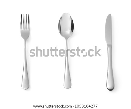 Photo of  Set of dessert cutlery spoon fork and knife stainless steel isolated on white background