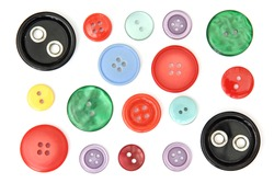 Set of different and colored sewing buttons, cut out and isolated on white background