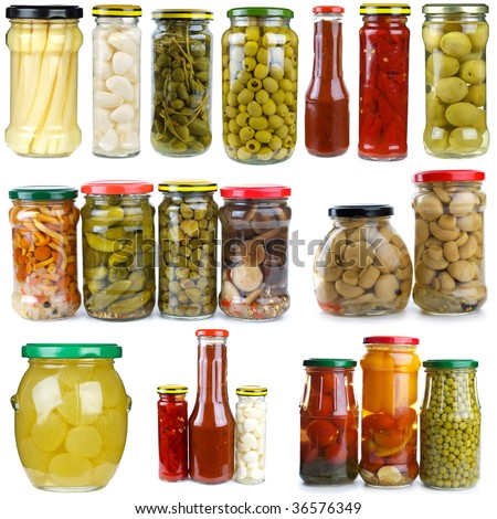 Set of different berries, mushrooms and vegetables conserved in glass jars isolated on the white background