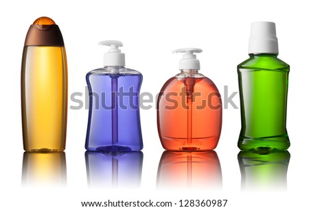Set of different bottles for beauty, hygiene and health on a white background with reflection, they shampoo, conditioner and other hair products, each of them shot on separately.