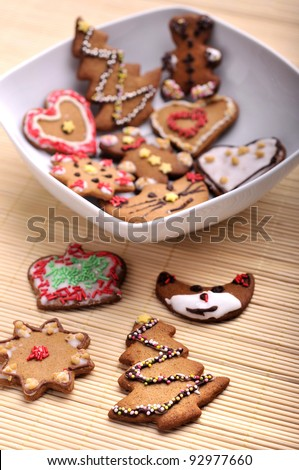 Set of different christmas cookies made of gingerbread on a plate