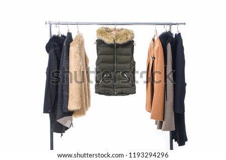 Set of different clothes ,fur coat for females on hanging