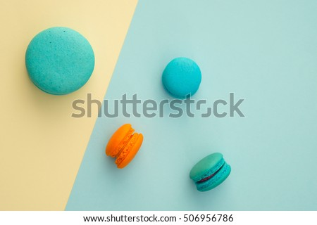 Set of different colorful macaroons on many colors background. Sweet and tasty for cooking and restaurant menu. Top view