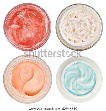 Set of 4 different dermal creams and gels isolated on white