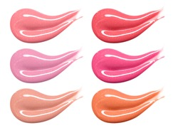 Set of different lip glosses pastel color smear samples isolated on white. Smudged makeup product sample.