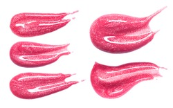 Set of different lip glosses smear isolated on white. Smudged makeup product sample.