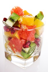 Set of different pieces fresh fruits in glass