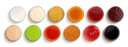 Set of different sauces isolated on white background, top view