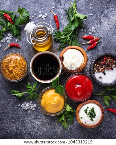 Set of different sauces. Ketchup, mayonnaise, mustard, soy sauce and tartar. Top view #1045319215