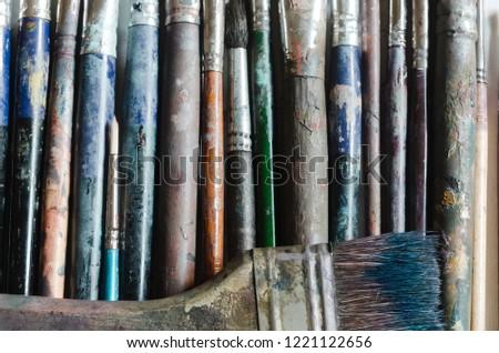 Set of dirty artist paintbrushes. Grunge brushes on white background. Creative mockup