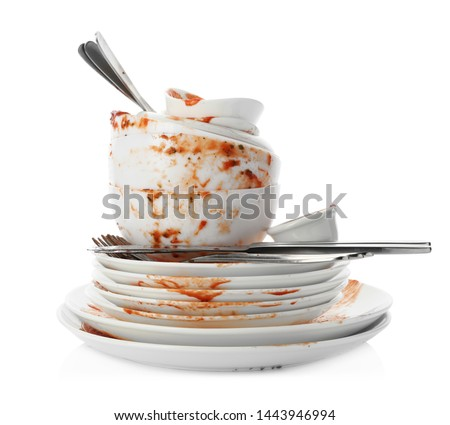 Set of dirty dishes isolated on white