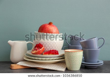 Set of dishware with fruit on table