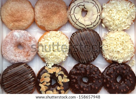 set of donuts in box close up