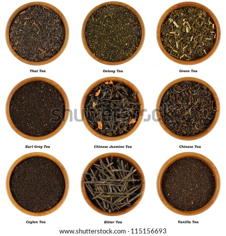 Set of Dried Tea Leaves in Wooden Bowls, Isolated on white background