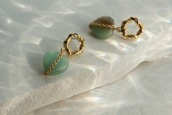 Set of earrings with aventurine stone heart shaped mint (green) color in gold chain on gold sventah
