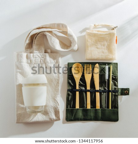 Set of Eco friendly bamboo cutlery, eco bag and  reusable coffee mug. Sustainable lifestyle.  Plastic free concept. #1344117956
