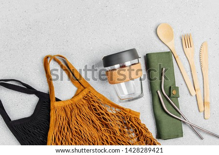 Set of Eco friendly bamboo cutlery, eco bag and reusable coffee mug. Sustainable lifestyle. Plastic free concept. #1428289421
