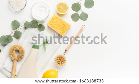 Set of eco friendly natural cleaning products, bamboo brush, lemon, baking soda, spray bottle on white background, copy space, panorama. Zero waste lifestyle