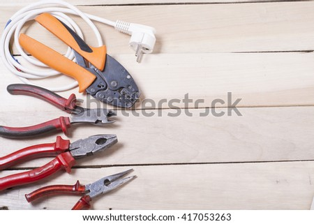 Set of electrical tool on wooden background. Accessories for engineering work, energy concept #417053263