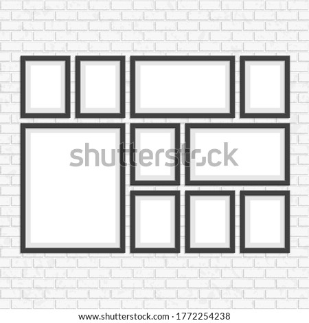 Set of empty frames in a room against a white, vintage brick wall. Photo art gallery on masonry wall. Interior mock up concept for your project. Seamless background white cube.