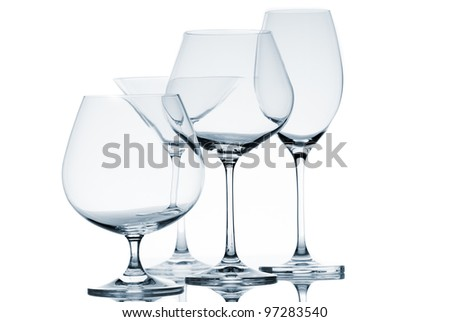 Set of empty glasses on white background