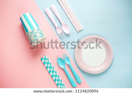 Set of empty, pastel paper tableware bowls, spoons and forks, straws  on color background. Untensils for a picnic. Flat lay. Top view #1124820896