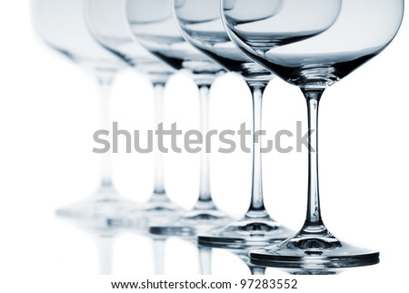 Set of empty wine glasses on white background.