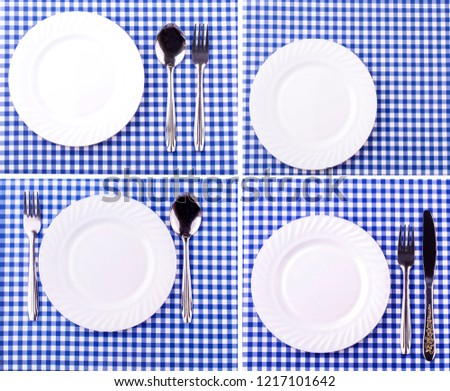 Set of empy plate on the tablecloth in a cage. View from above with copy space