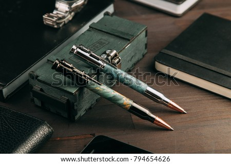 set of expensive military pens in wooden boxes, compositions on a dark background with attributes #794654626
