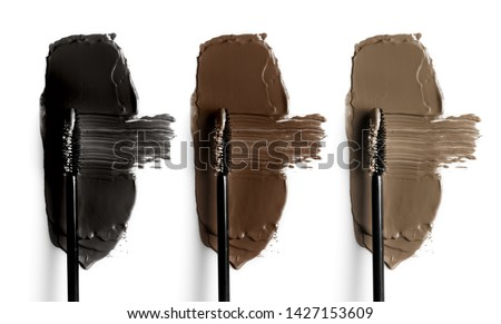 Set of eyebrow mascara swatches. Brush strokes of different shades of mascara. Colorful isolated on white background.