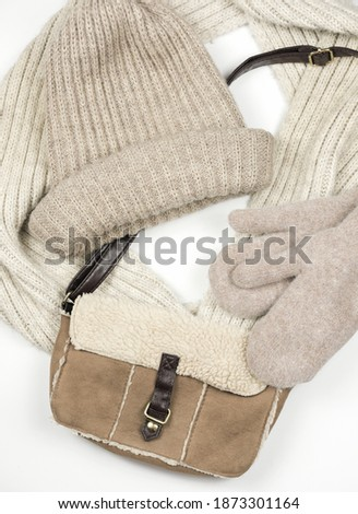 set of fashionable women's winter accessories on a white background top view. Autumn or winter hat and mittens. leather bag and scarf in beige neutral tones Photo stock ©