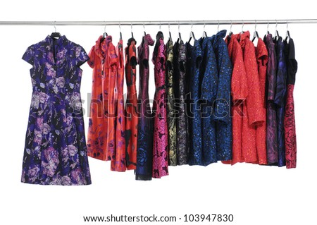 Set of female dress isolated on hanging
