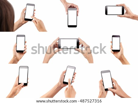 Set of female hands holding black modern cellphone with blank screen at isolated white background. #487527316