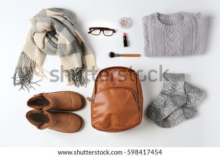 Set of female stylish clothes on white background