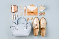 Set of Feminine accessories  with handbag, watch, note and beauty products.