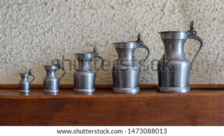 Set of five antique pewter jugs of different sizes. #1473088013