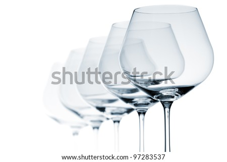 Set of five empty wine glasses on white background