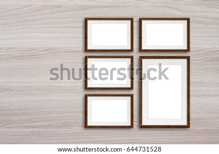 Free photos Blank frames collage on brown wooden panels wall ...