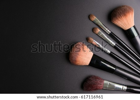 Set of flat top view of various professional female cosmetics brushes for makeup and eyelash brush isolated on black background, Cosmetics concept, Make up concept, Copy space image for your text.