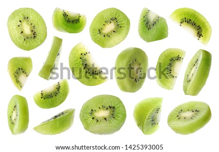 Set of flying cut fresh juicy kiwi on white background
