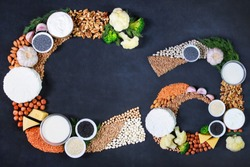 Set of food that is rich in calcium. Top view. Cottage cheese, curd, cheese, milk, yogurt, beans, chickpeas, greens, garlic, nuts, broccoli, cabbage, poppy, yogurt, sesame, lentils, poppy.