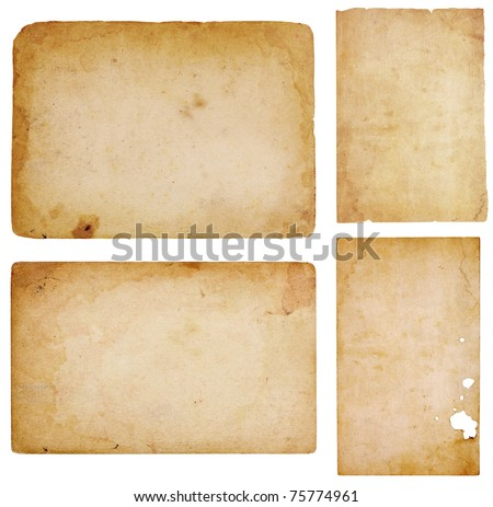 Set of four aged, worn and stained paper scraps isolated on white with room for text or images.
